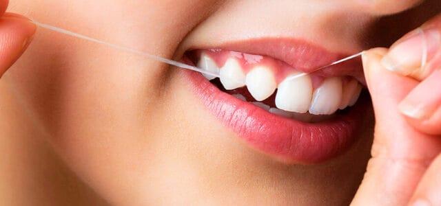Cómo usar el hilo dental